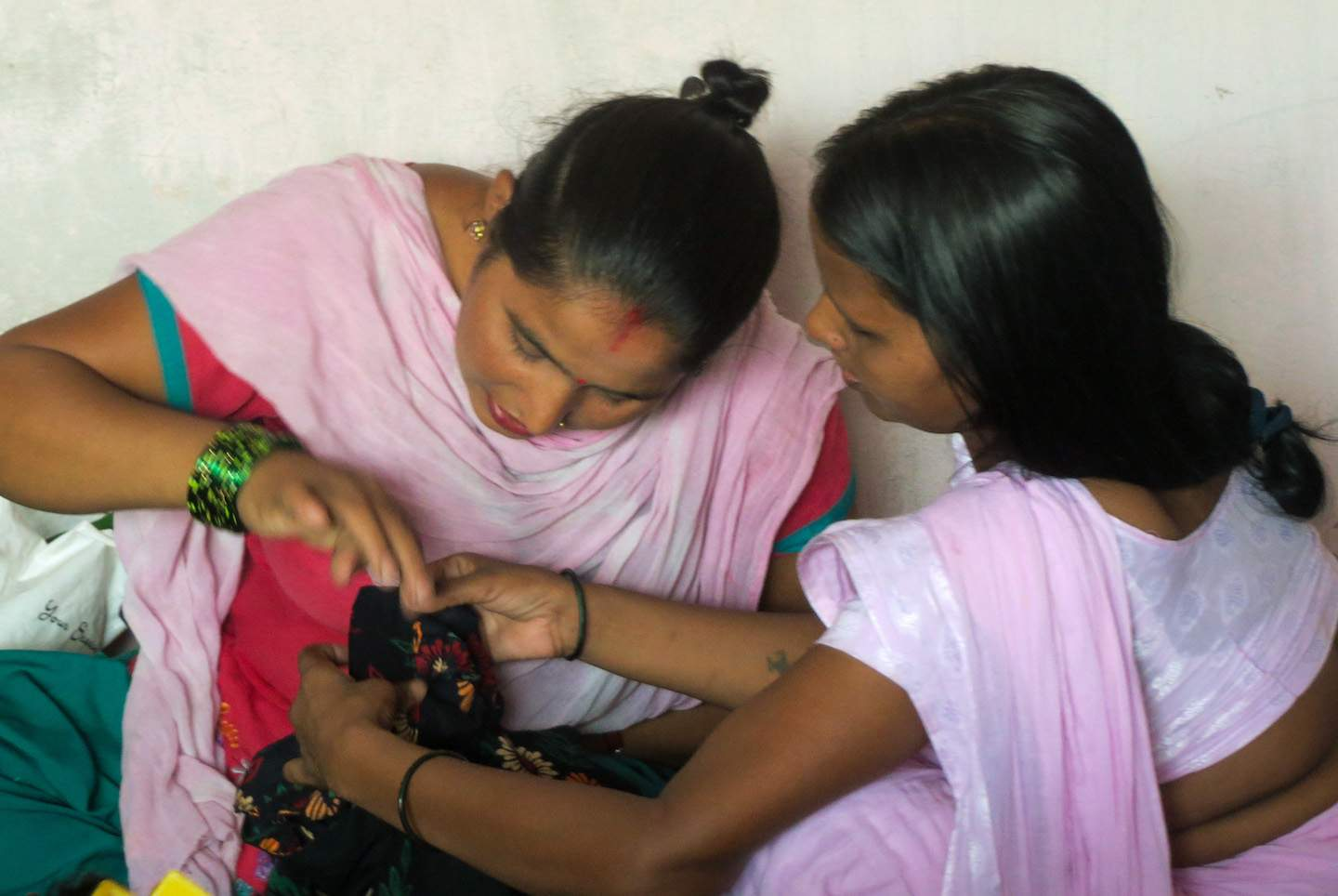 Through IGO evangelists, two women develop skills with a sewing machine, enabling them to escape from the discrimination single women face in India.