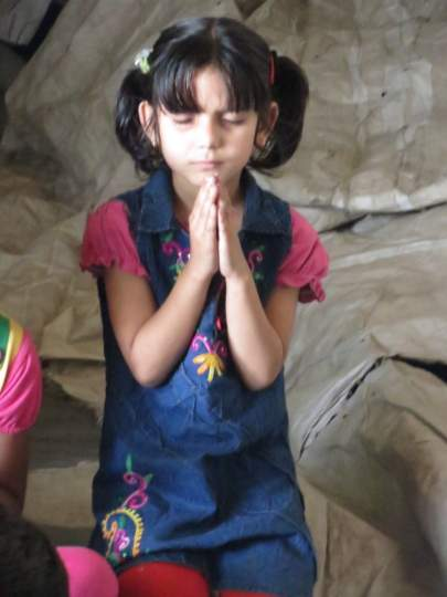 At an IGO school in Ludhiana's slums, a young girl learns to pray to God the Father who loves her as much as He loves the boys in her class.