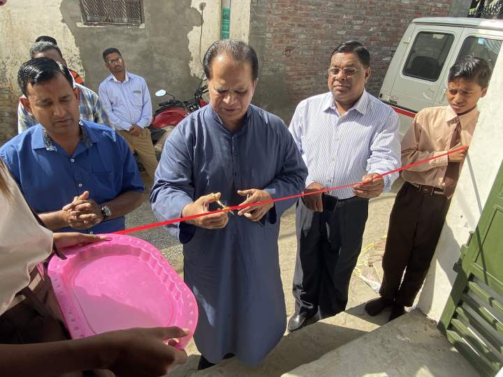 "IGO President Valson Abraham cuts the ribbon and dedicates brand-new facilities for the ""dairy complex"" Asha Kiran school in Ludhiana, Punjab. On the right is Pastor K. Koshy, Director, IGO Northwest India."